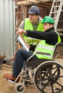 Man in wheelchair working as an architect